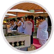 Worshippers In Front Of The Royal Temple  At Grand Palace Of Tha Round Beach Towel