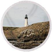 Yaquina Head Lighthouse From The Beach Round Beach Towel