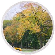 Yellow Nyc Taxi Driving Through Central Park Usa Round Beach Towel