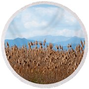 Yellow Reeds And Blue Mountains Round Beach Towel