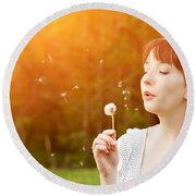Young Beautiful Woman Blowing A Dandelion In Spring Scenery Round Beach Towel