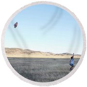 Young Lady Flies A Kite In An Open Round Beach Towel