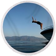 Young Man Flips Off A Boat At Sunset Round Beach Towel