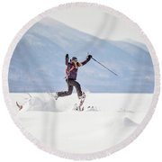 Young Woman Jumping While Snowshoeing Round Beach Towel