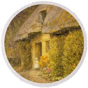 A Child At The Doorway Of A Thatched Cottage  Round Beach Towel