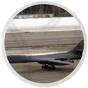 A B-1b Lancer Performs A Touch And Go Round Beach Towel