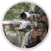 A Sniper Sights In On A Target Round Beach Towel