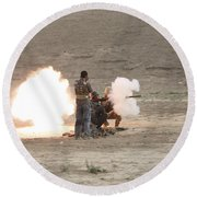 An Afghan Police Studen Fires Round Beach Towel
