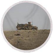 An Mrap Vehicle Patrols The Ridge Round Beach Towel