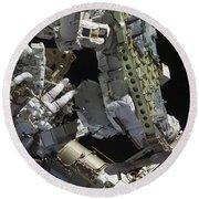 Astronauts Working On The International Round Beach Towel