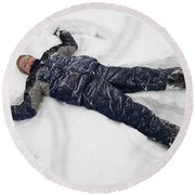 Boy And Snow Angel Round Beach Towel