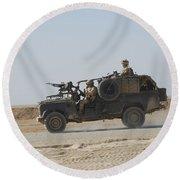 British Soldiers Patrol Afghanistan Round Beach Towel