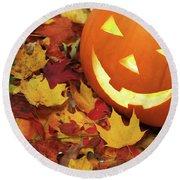 Carved Pumpkin On Fallen Leaves Round Beach Towel