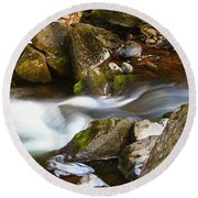 Flowing River Blurred Through Rocks Round Beach Towel