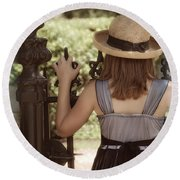 Girl Looking Over Iron Gate Round Beach Towel