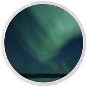Green Aurora Above Far Lake Round Beach Towel