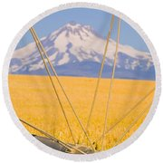 Irrigation Pipe In Wheat Field With Round Beach Towel