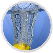 Lemon Dropped In Water Round Beach Towel