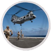 Marines Fast Rope On To The Flight Deck Round Beach Towel