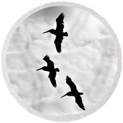 Pelicans On The Wing Round Beach Towel