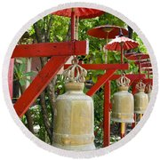 Row Of Bells In A Temple Covered By Red Umbrella Round Beach Towel