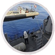 Sailors Lower A Rigid Hull Inflatable Round Beach Towel