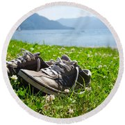 Shoes On The Green Grass Round Beach Towel