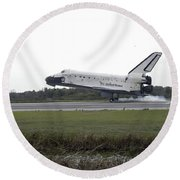 Space Shuttle Discovery Touches Round Beach Towel
