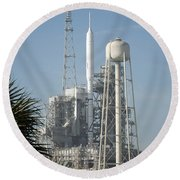 The Ares I-x Rocket Is Seen Round Beach Towel