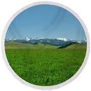 The Crazy Mountains Round Beach Towel