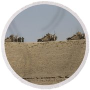Three M-atvs Guard The Top Of The Wadi Round Beach Towel