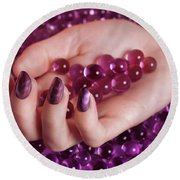 Woman Hand With Purple Nail Polish On Candy Round Beach Towel