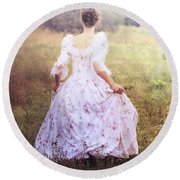 Woman In A Meadow Round Beach Towel