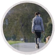 Woman Walking With Her Dogs Round Beach Towel