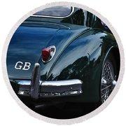 1956 Jaguar Xk 140 - Rear And Emblem Round Beach Towel