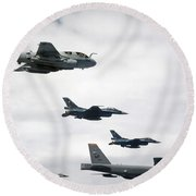 A B-52 Stratofortress Leads A Formation Round Beach Towel