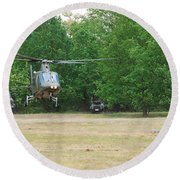 An Agusta A109 Helicopter Round Beach Towel by Luc De Jaeger