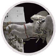 Astronaut Working On The International Round Beach Towel