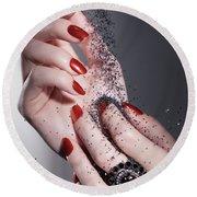 Black Sand Falling On Woman Hands Round Beach Towel by Oleksiy Maksymenko