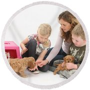 Family With Cockerpoo Pups Round Beach Towel