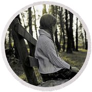 Girl Sitting On A Wooden Bench In The Forest Against The Light Round Beach Towel