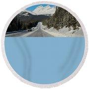 Highway In Winter Through Mountains Round Beach Towel