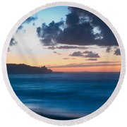 A Beach During Sunset With Glowing Sky Round Beach Towel