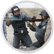 An Afghan Police Student Loads A Rpg-7 Round Beach Towel