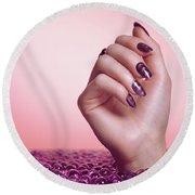 Woman Hand With Purple Nail Polish Round Beach Towel