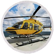 A Bell 407 Utility Helicopter Round Beach Towel
