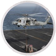 A Mh-60s Knighthawk Conducts A Vertical Round Beach Towel