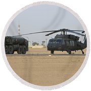 A Uh-60 Black Hawk Helicopter Round Beach Towel
