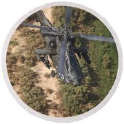 An Ah-64d Apache Helicopter In Flight Round Beach Towel
