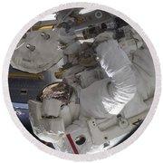 Astronaut Working On The International Round Beach Towel